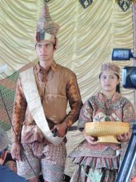 Dressed in folk costumes made from tree barks to welcome guests