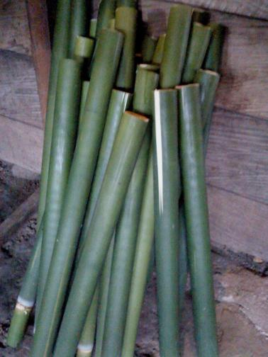 Bamboo coated with banana leaves inside